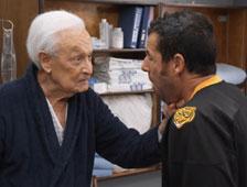Vídeo: Adam Sandler se pelea con Bob Barker en una reunión de Happy Gilmore